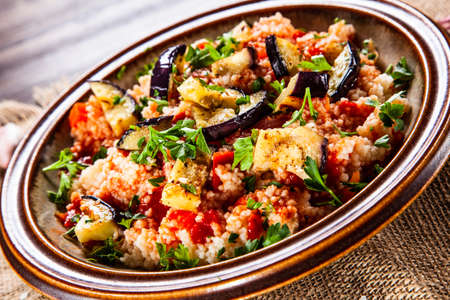 Couscous with sauce and vegetables Stock Photo