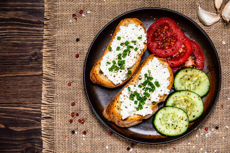 Sandwiches with cottage cheese and vegetables