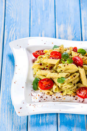 Pasta with herbs and vegetables on wooden background 写真素材