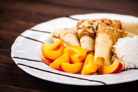 Sweet crepes with apricots