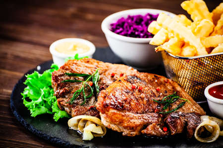 Grilled steak with french fries and vegetables