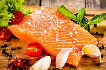 Fresh raw salmon fillets on cutting board