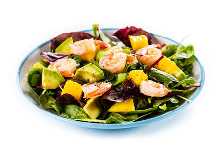 Salad with shrimps on white background