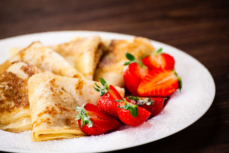 Crepes with cream and strawberries Banco de Imagens
