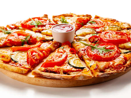Sliced margherita pizza on white background