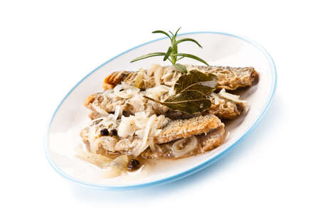 Fried herrings in vinegar on white background
