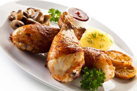 Barbecue chicken drumsticks with boiled potatoes and mushrooms