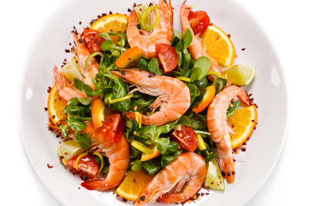 Prawns with vegetables on white background