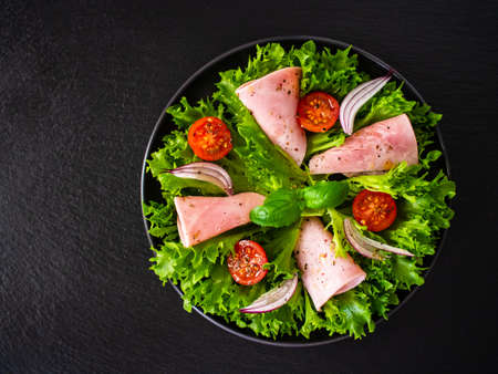 Salad with ham and vegetables and seasonings