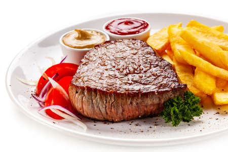 Grilled steak with french fries with cetchup and mustard Reklamní fotografie
