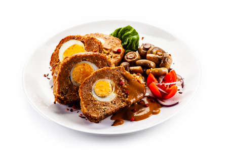 Meatballs stuffed with egg, champignon and vegetables