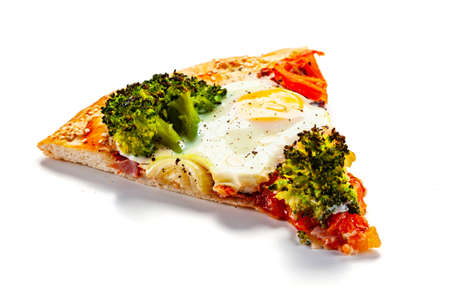 Slice of pizza with egg, broccoli, tomatoes and champignon