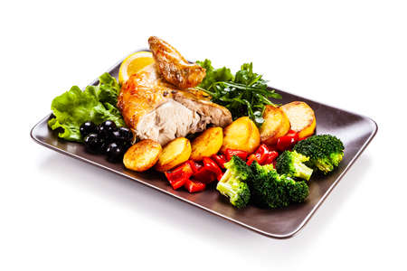 Grilled chicken meat with baked potatoes and vegetables