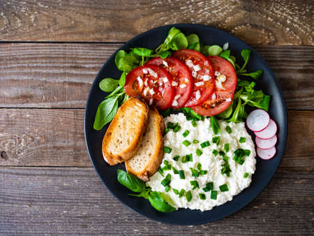 Breakfast - cottage cheese, toasted bread and vegetables Stock Photo