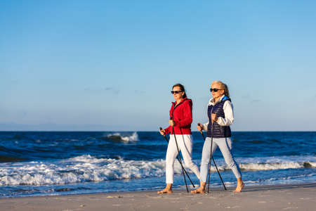 Nordic walking - two women working out on beach Reklamní fotografie