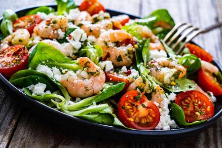 Prawn salad on wooden table