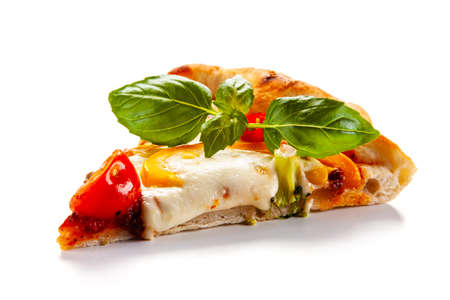 Slice of margherita pizza on white background