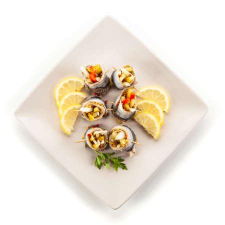 Marinated herring fillets on white background Stock Photo