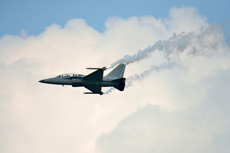 domestically: fighter jet - airshow,  fighter pilot flying domestically