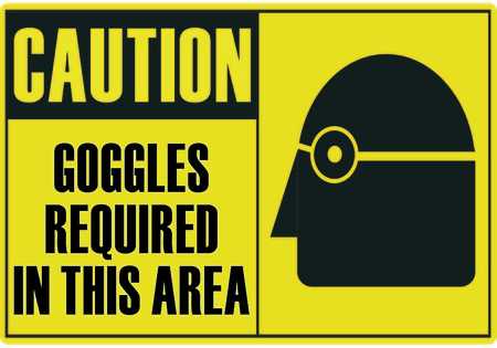 required: Caution safety sign Goggles required in this area