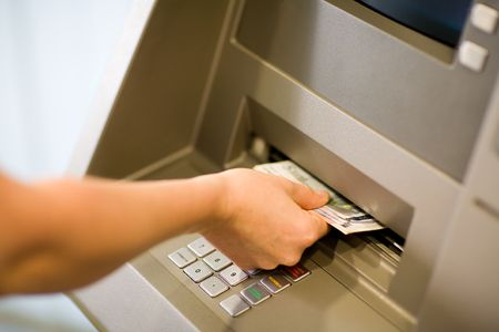 Getting Money (Euros) at a atm. Close-up.