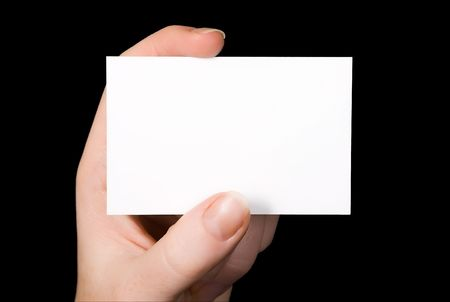 An empty white Business Card isolated on black background. Great for your own ideas and concepts!