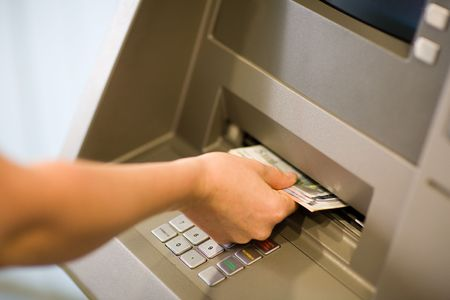 Getting Money (Euros) at a atm. Close-up. Stock Photo - 895519