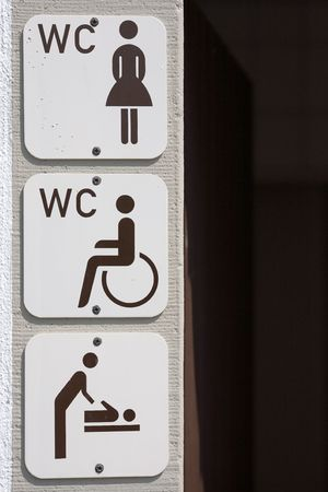 information signs on housewall for disabled, women and  change