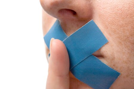 Censored Woman with blue tape on mouth. Finger before lips. Isolated on white. Stock Photo