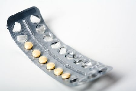 Birth control pills in used Blister pack. White background.