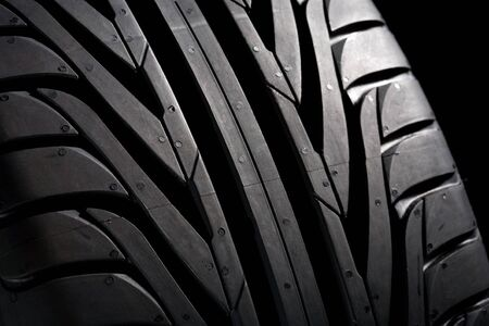 pneu: Summer tire (22545R17) on black background. Its a new one. Close-Up. Stock Photo