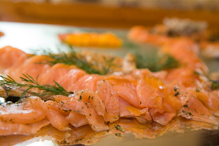Close-up party platter full of sliced salmon. Focus on front salmon. Stock Photo - 1481287
