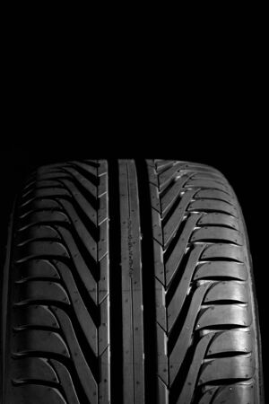 pneu: Summer tire (22545R17), isolated on black. Frontal view with copyspace above. Stock Photo