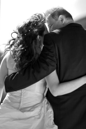 bridal couple: Bridal couple lovely hugging each other. View from behind, Monochrome.