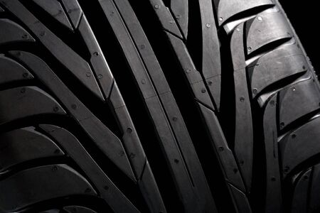 pneu: Detail of a new black tyre. Profile-close-up. Stock Photo