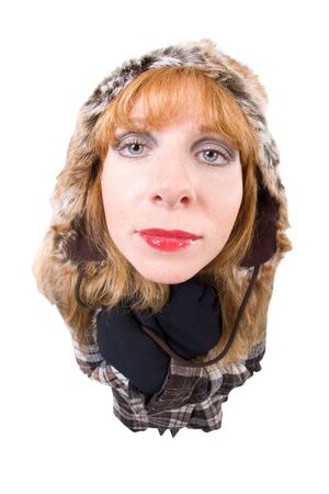 winterly: Woman with Winterclothes looking into camera. Overstated Fisheye-Effect. Isolated on white.