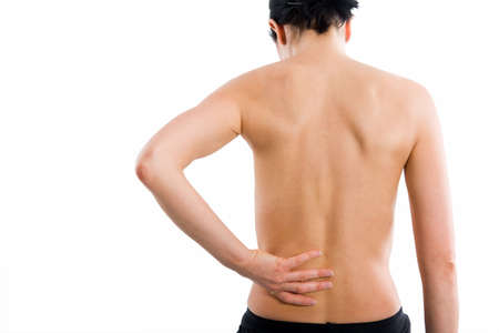 Sporty woman from behind holding her lower back because of backache Stock Photo - 2187141