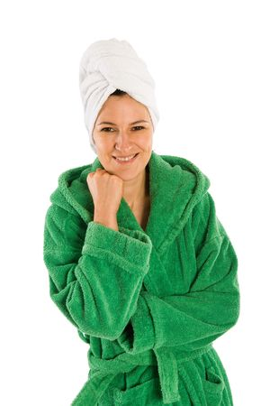 Nice woman in green bath robe and towel wrapped around her head