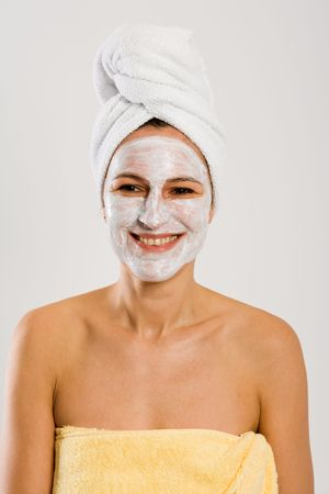 Nice woman laughing. With facemask and towel on head and body. photo