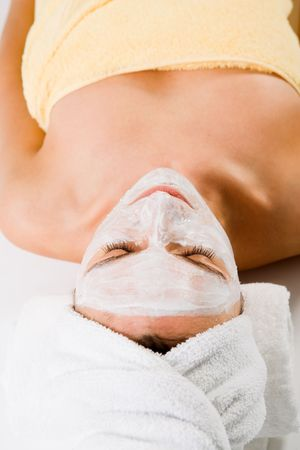 facemask: Wellness - woman from behind. Sleeping with facemask and towels. Stock Photo