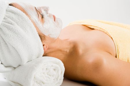 Woman with facial mask lying on neck support while sleeping. photo