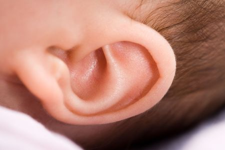 Closeup of a 3 months old babys ear. Much details. Stock Photo