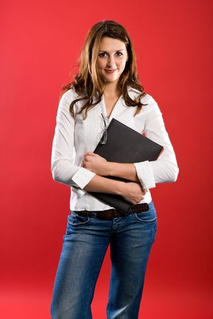 Nice woman holding a black folder before her chest. photo