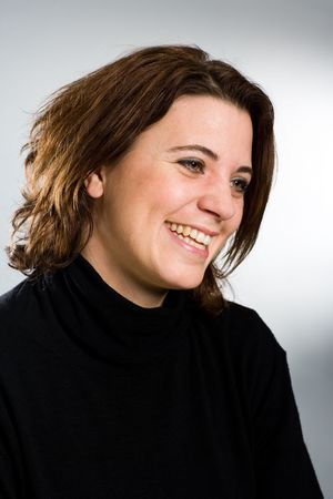zealous: Portrait of a laughing woman in black pullover Stock Photo