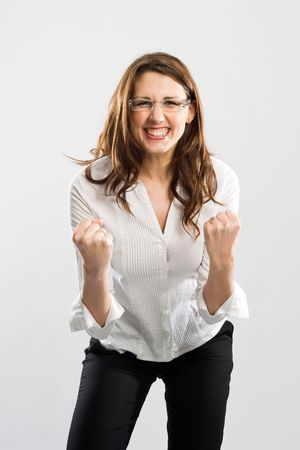 Woman showing energetic and jolly triumph pose. She was successful. Stock Photo