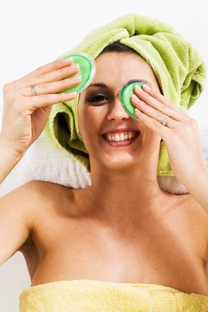 Woman lifting one eye pad and laughing to you.