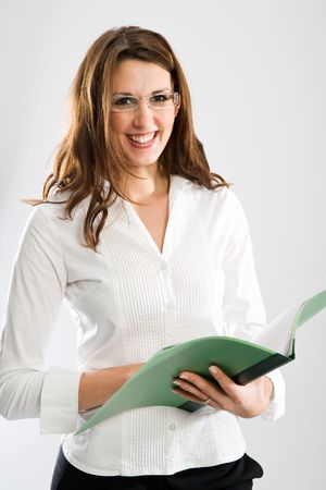 Attractive female wearer of eyeglasses smiling to you while holding a map. White background.