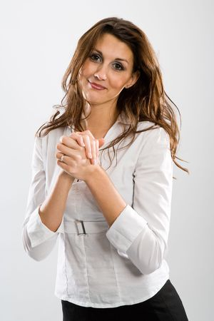 obliged: Nice woman in a grateful pose. White background.