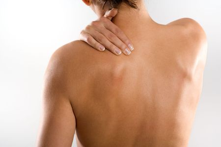 Woman from behind, naked body, holding her neck on the left side. Nearly no head.