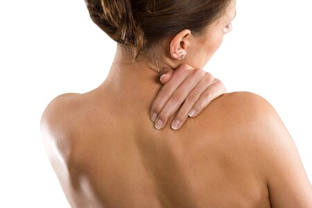 Woman from behind, naked body, holding her neck on the right side. Face to the right. photo